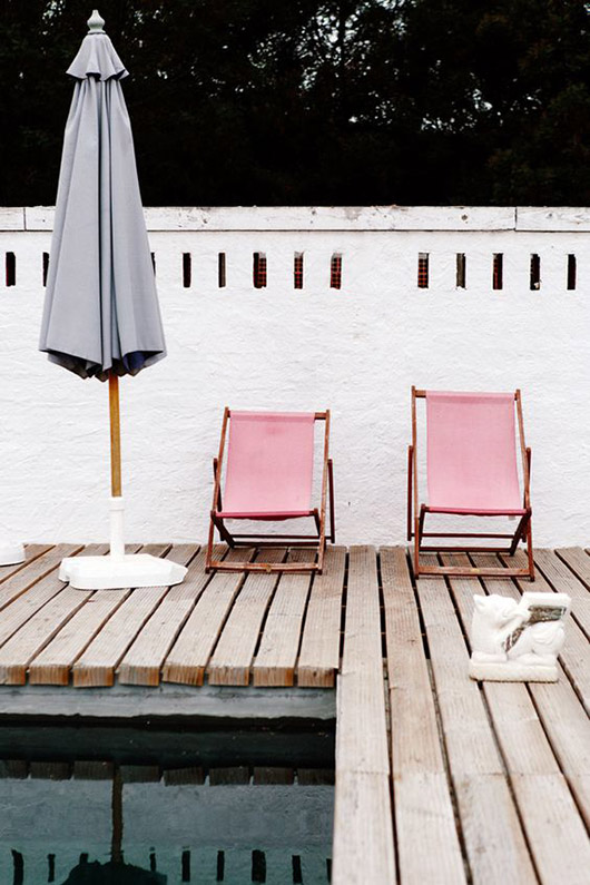 pink lounger chairs poolside. / sfgirlbybay