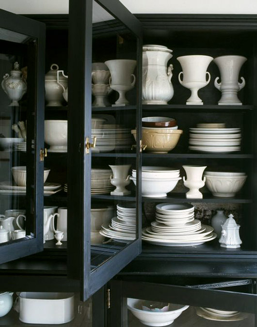 black cabinet with white ceramic dishes. / sfgirlbybay