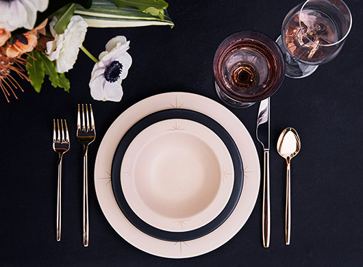 black and white cermic dishes with gold decals by amy hamley. / sfgirlbybay