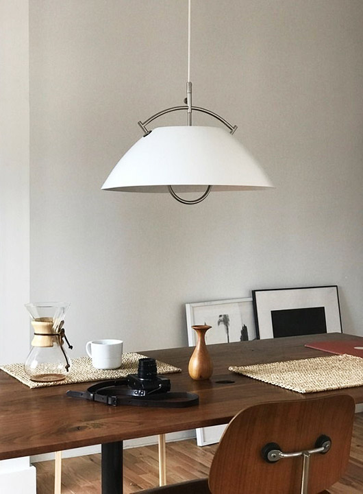 simple dining space with modern hanging light fixture. / sfgirlbybay