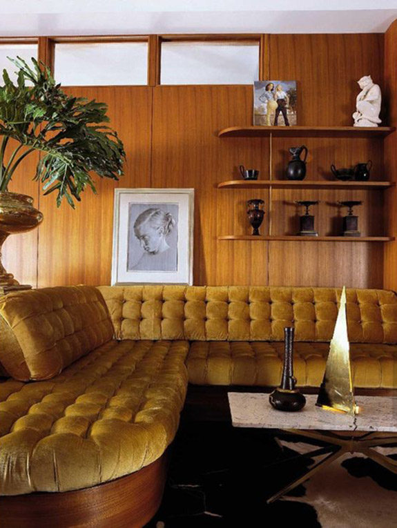 wood paneled living room with mustard velvet tufted sectional. / sfgirlbybay