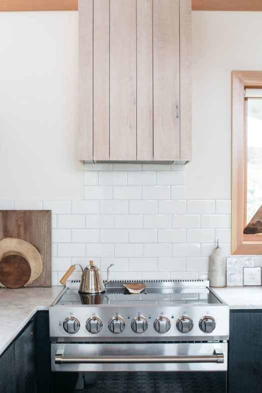 white subway tile and whitewashed wood in modern malibu kitchen. / sfgirlbybay