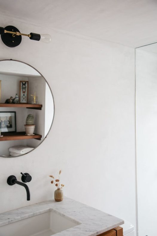 circle mirror and marble vanity in modern bathroom. / sfgirlbybay