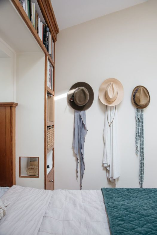 hats hung on wall of tiny venice canals home. / sfgirlbybay