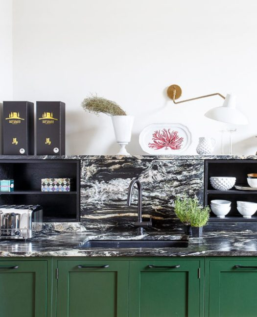 dark green kitchen cabinets with black and white marble countertops. / sfgirlbybay