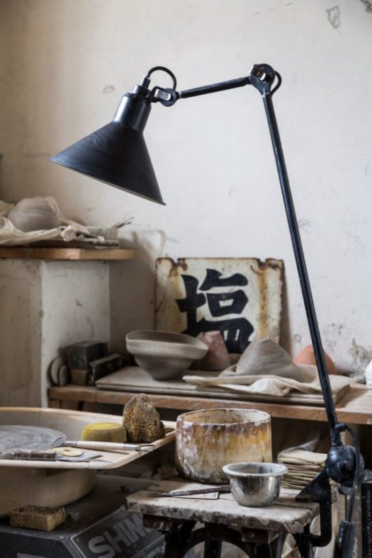 industrial task lamp in artist Ema Pradère's ceramic studio in paris. / sfgirlbybay