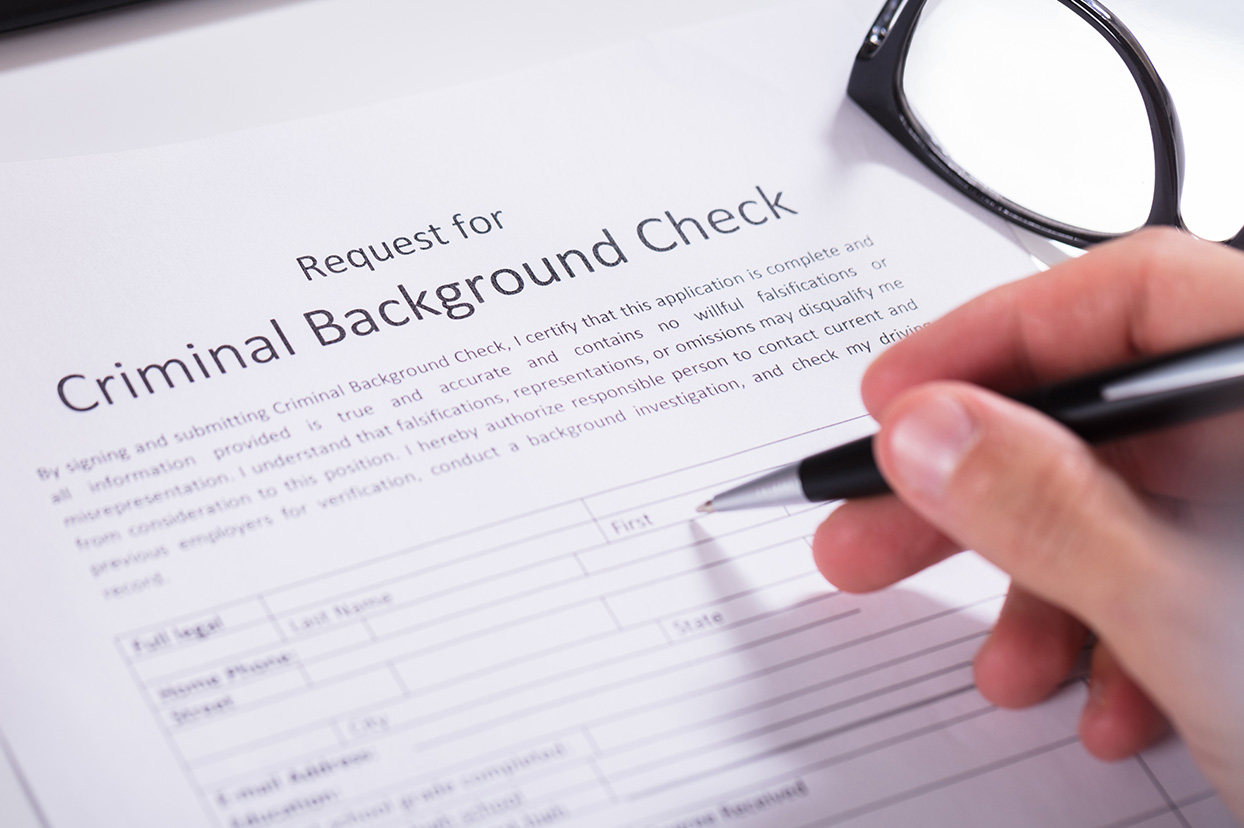 Ban the Box  doesn t prevent criminal background check Person filling out criminal background check form