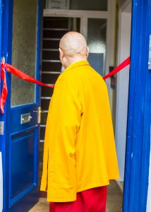 Picture of Choje Lama Yeshe Rinpoche cutting the ribbon of the new Tibetan Centre
