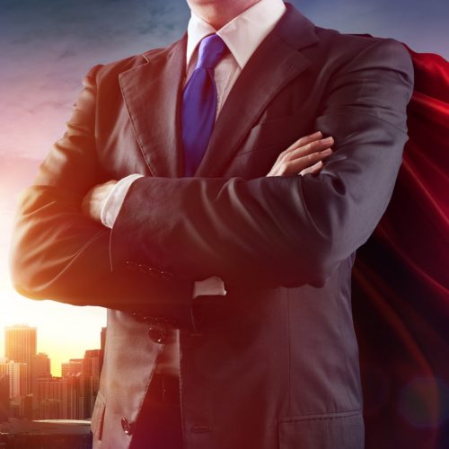 Businessman Superhero With Red Cape Dominates The City