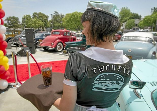 A waitress in a vintage uniform serves drinks to guests at Twohey's Restaurant in Alhambra during the eatery's 70th anniversary in May 15, 2013. (SGVN/Staff photo by Leo Jarzomb)