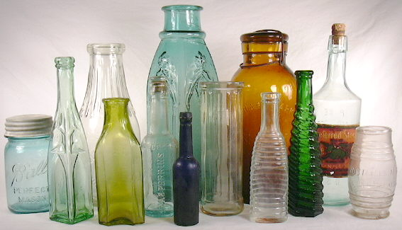 Grouping of food bottles dating from the 1860s to 1930s; click to enlarge.