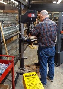 Jon using the drill press at Rockler