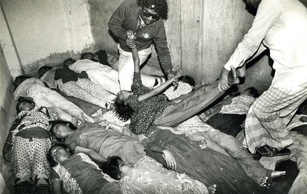 Photo of children killed in garment factory fire, by Azizur Rahim Peu. I often use this photograph in my lectures.