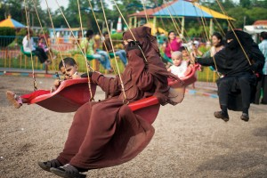Grownups in charge of little ones whiz by. Photo: Aneek Mustafa Anwar