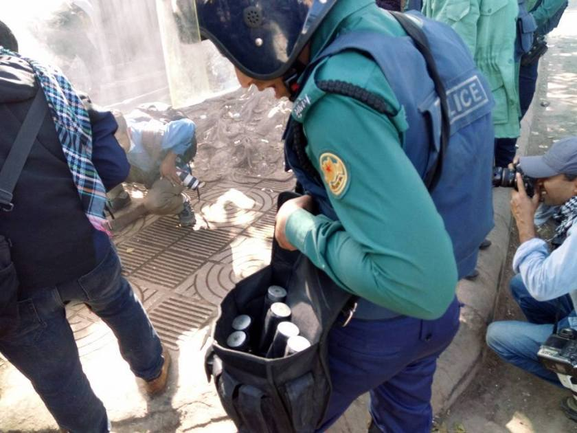 Empty teargas canisters being collected by a policeman, Shahbagh, January 26, 2017. ? Photographer unknown