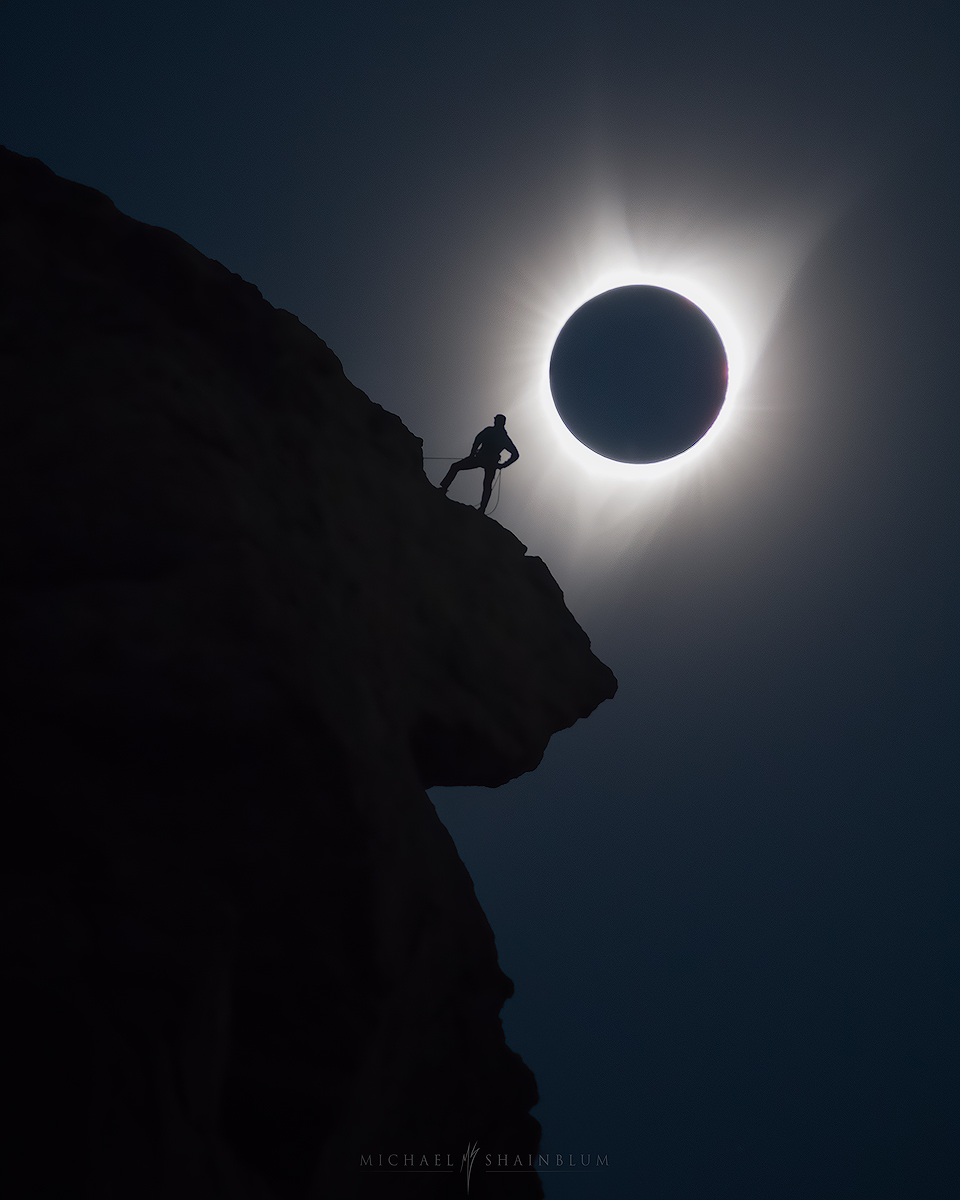 Solar eclipse Photo of Smith Rock and climber in Bend, Oregon by Michael Shainblum