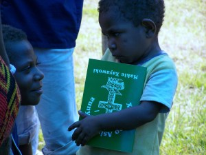 Garia boy holds Book of Mark