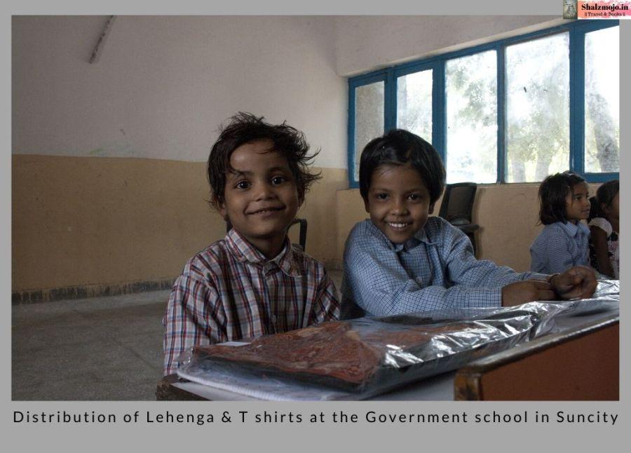 world-school-children-slum-construction site-diwali-lehenga-clothes-distribution