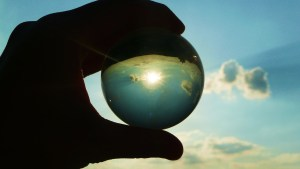 Holding glass sphere to sky