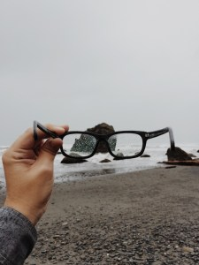 holding glasses rain spots