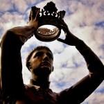 statue of crown held over head
