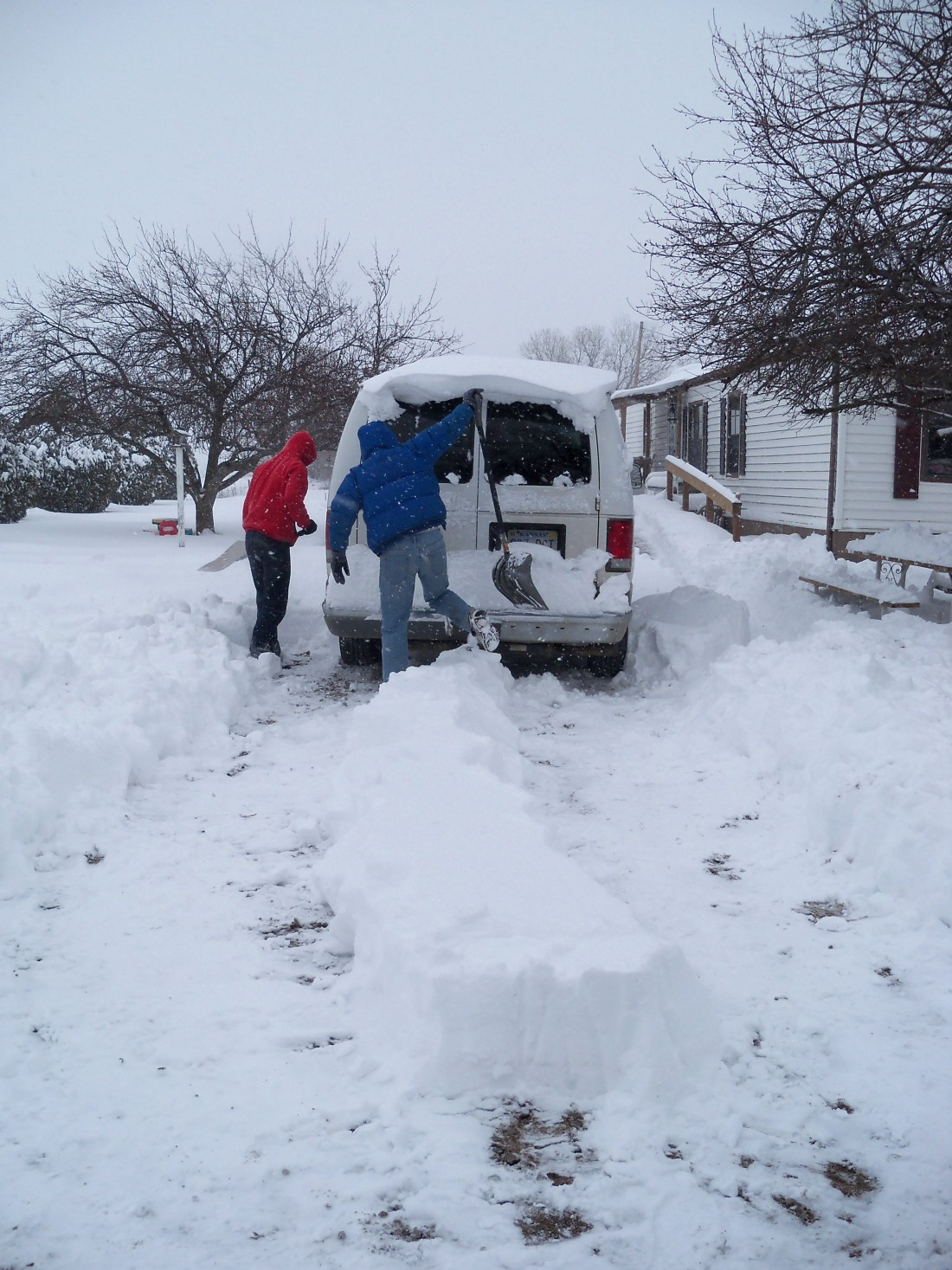 The boys shoveled snow and made necessary paths.