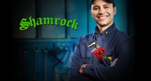 Happy shamrock plumber with wrench