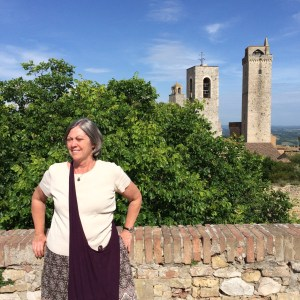 Cathe stands in front of some of San Gimignano's famous towers.