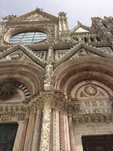 The Siena cathedral has white, pink, and green marble in the facade.