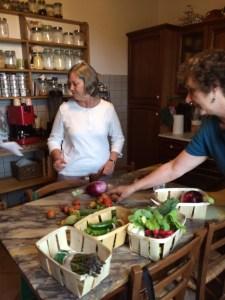 Cathe and Nancy help sort and chop veggies.