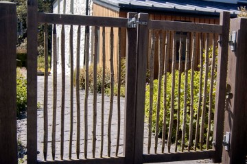 Double garden gates. Oak frame with hazel palisades.