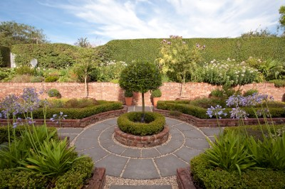 Circular path and beds form the herb garden of this smallholding.