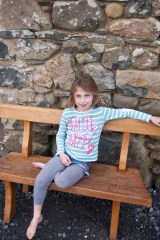 Garden Furniture - Child sitting on a small Welsh oak bench