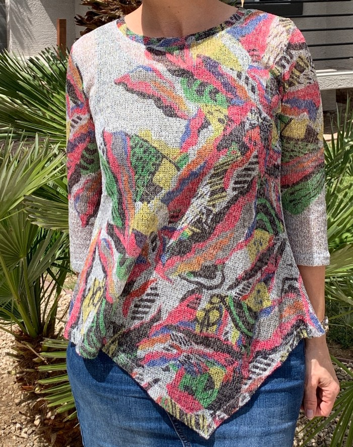 Asymmetrical print sharkbite top