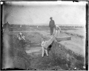 a_trench_at_the_potters_field_on_hart_island_circa_1890_by_jacob_riis