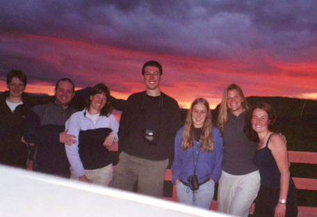 Group photo of the sunset watchers, including the hood of the Isuzu Trooper on which my camera was resting.