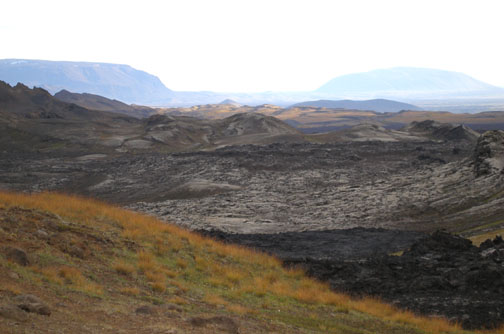 Same viewpoint, facing the other direction. The black rocks in the foreground are also part of that recent lava flow.
