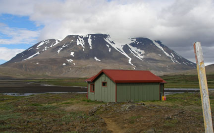 """Our first destination: Þverbrekknamúli, which we called """"Breakfast Muesli"""" for easier pronunciation. The weather-beaten stick to the right of the frame is what happens when you leave painted lumber out in the elements of Iceland: rain, wind, ice, sandstorms, 24-hour sunlight... it takes its toll. It used to be red and yellow."""