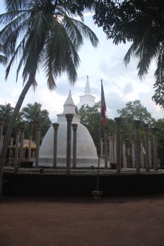 The pillars once supported a roof meant to protect the stupa beneath. The pillars remain, and the stupa has been rebuilt, but the roof turned to dust centuries ago.
