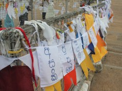 These are prayer flags requesting help for illnesses and trouble; kind of sad, actually.