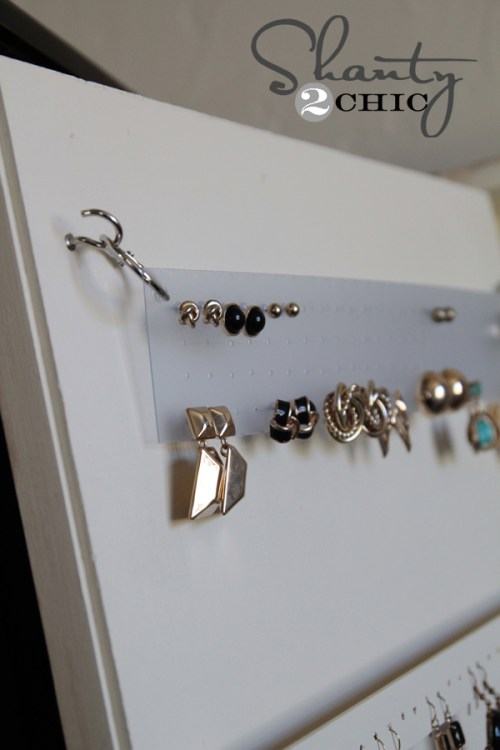 plastic and a hole punch for earring storage