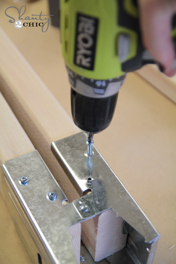 Attach sawhorse clamp to wood