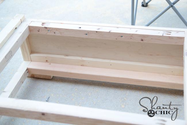 Drawer slides at base of bed