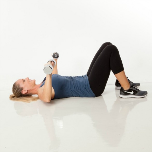 Lie face-up on the floor or on a bench with knees bent and feet flat, holding dumbbells. Bend arms and open elbows out to sides of shoulders at a 90-degree angle, elbows just above the floor.