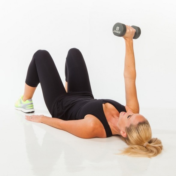 Lie faceup on a mat or bench with knees bent and hip-width apart and feet flat, holding a dumbbell with right hand. Extend arm up to the ceiling in line with right shoulder, left arm extended down by side, bracing abs in tight.