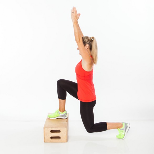 Begin in a split stance with right foot on top of a box or step. Lower into a lunge, bending back knee directly under hip, as both arms extend overhead.