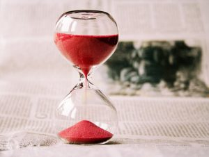 Egg timer with red sand flowing