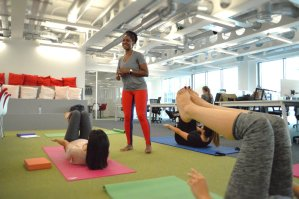 Corporate yoga and Pilates class in open plan office