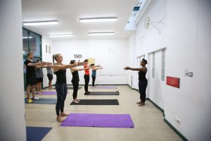 People standing and working on exercise class in West Hampstead