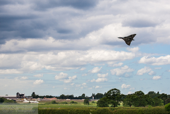 Avro Vulcan XH558 waggling its wings over Woodford Aerodrome and Vulcan XM603